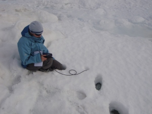 Helen measuring conditions under the snow
